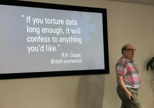 """On screen slide says:""""if you torture data long enough, it will confess to anything you like""""-R.H. Coase, British economist"""""""