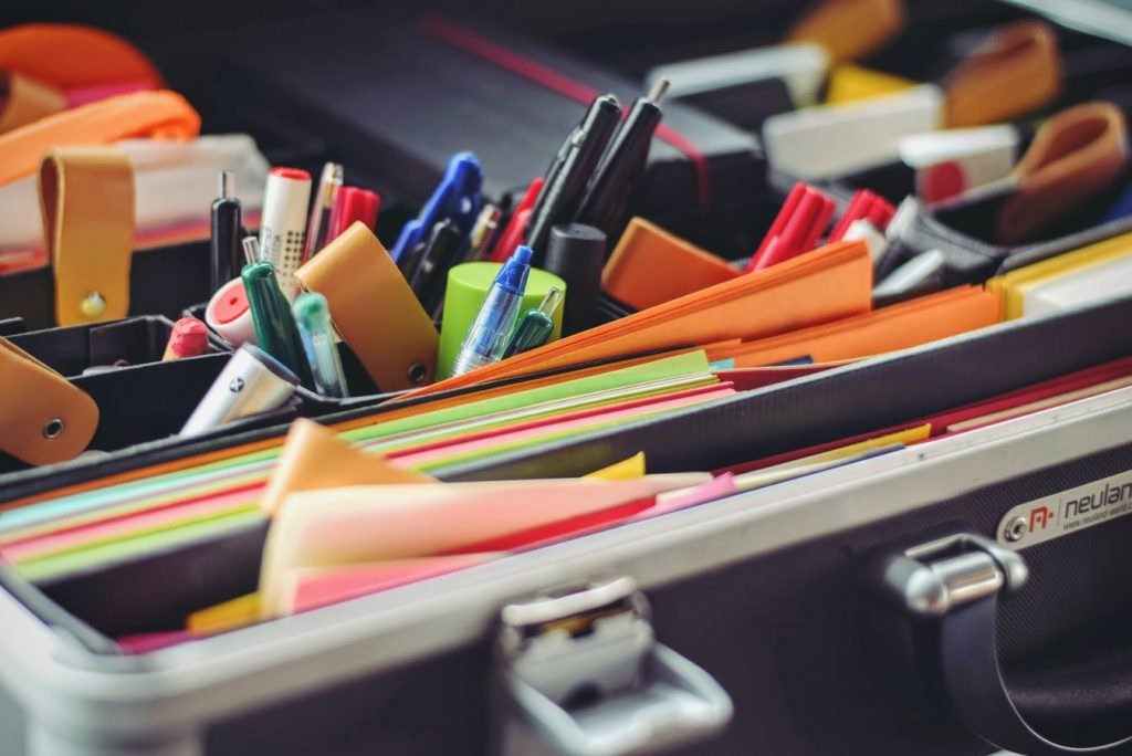 pens and post it on a busy desk