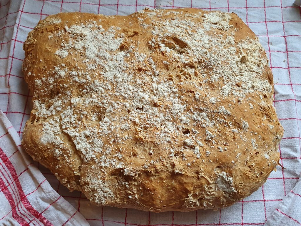 Bread just out of the oven, on a kitchen cloth