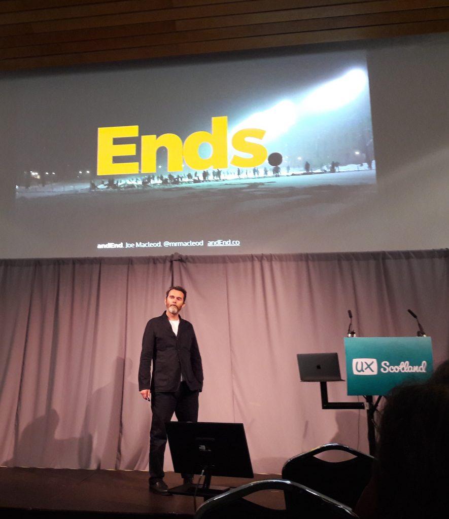 Joe Macleod on stage during his talk