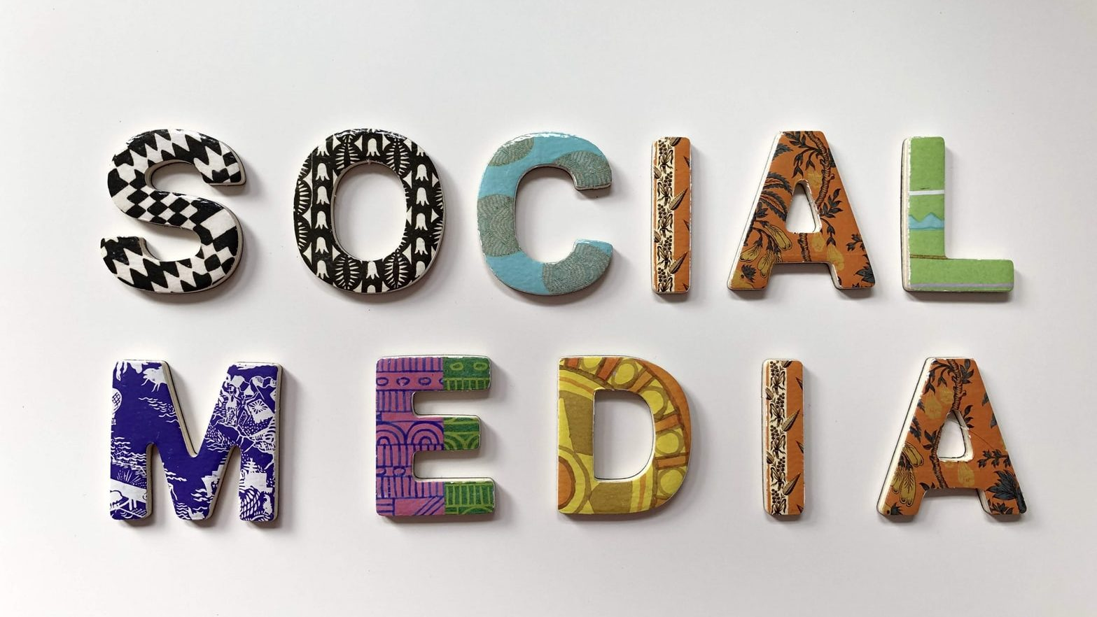 colourful ceramic letters forming the words: Social Media
